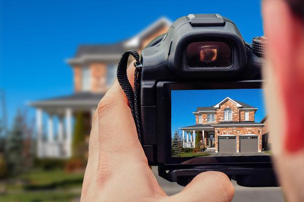 man taking photo of real estate image